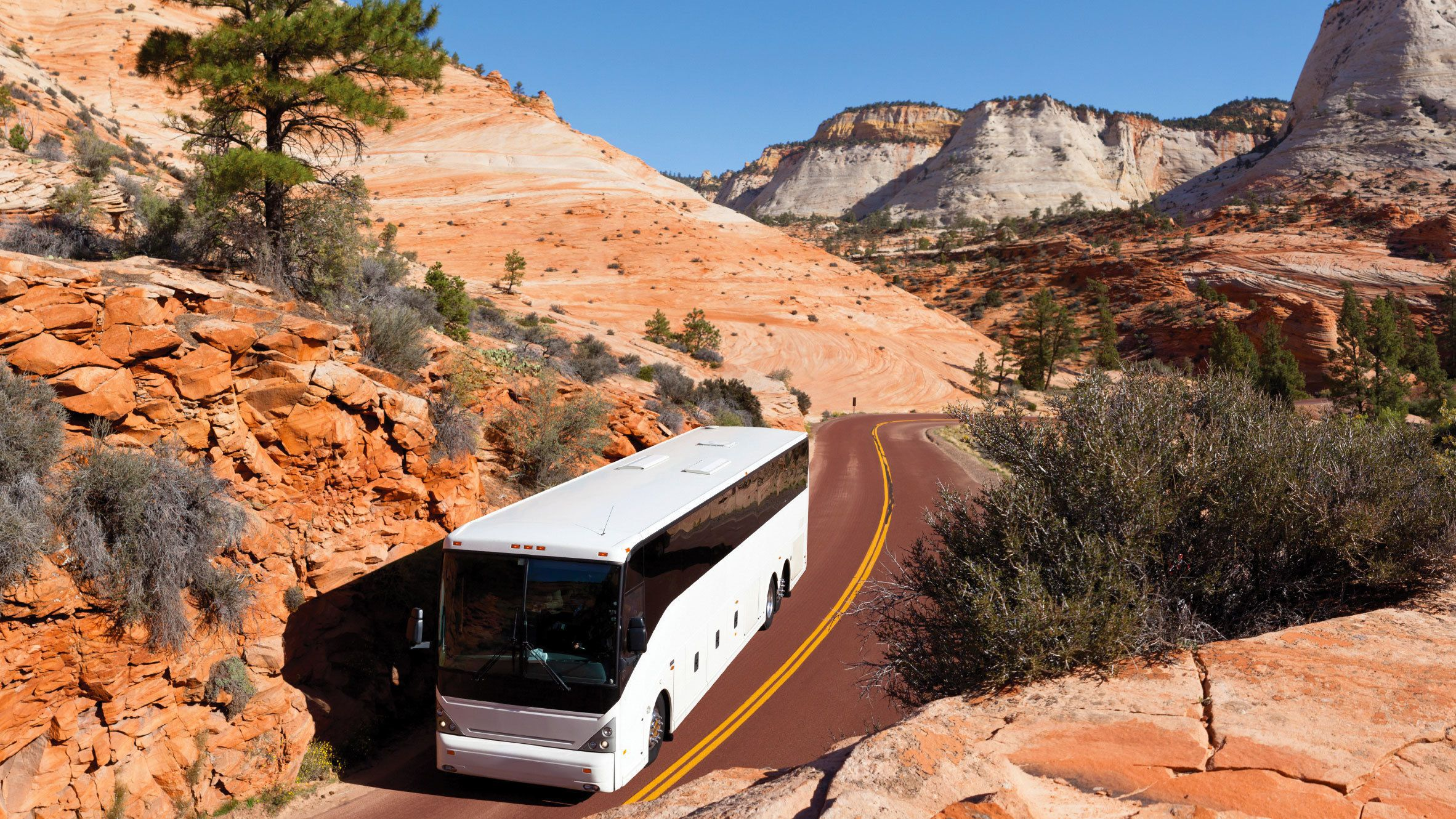 Moving tour bus at the base of the Grand Canyon