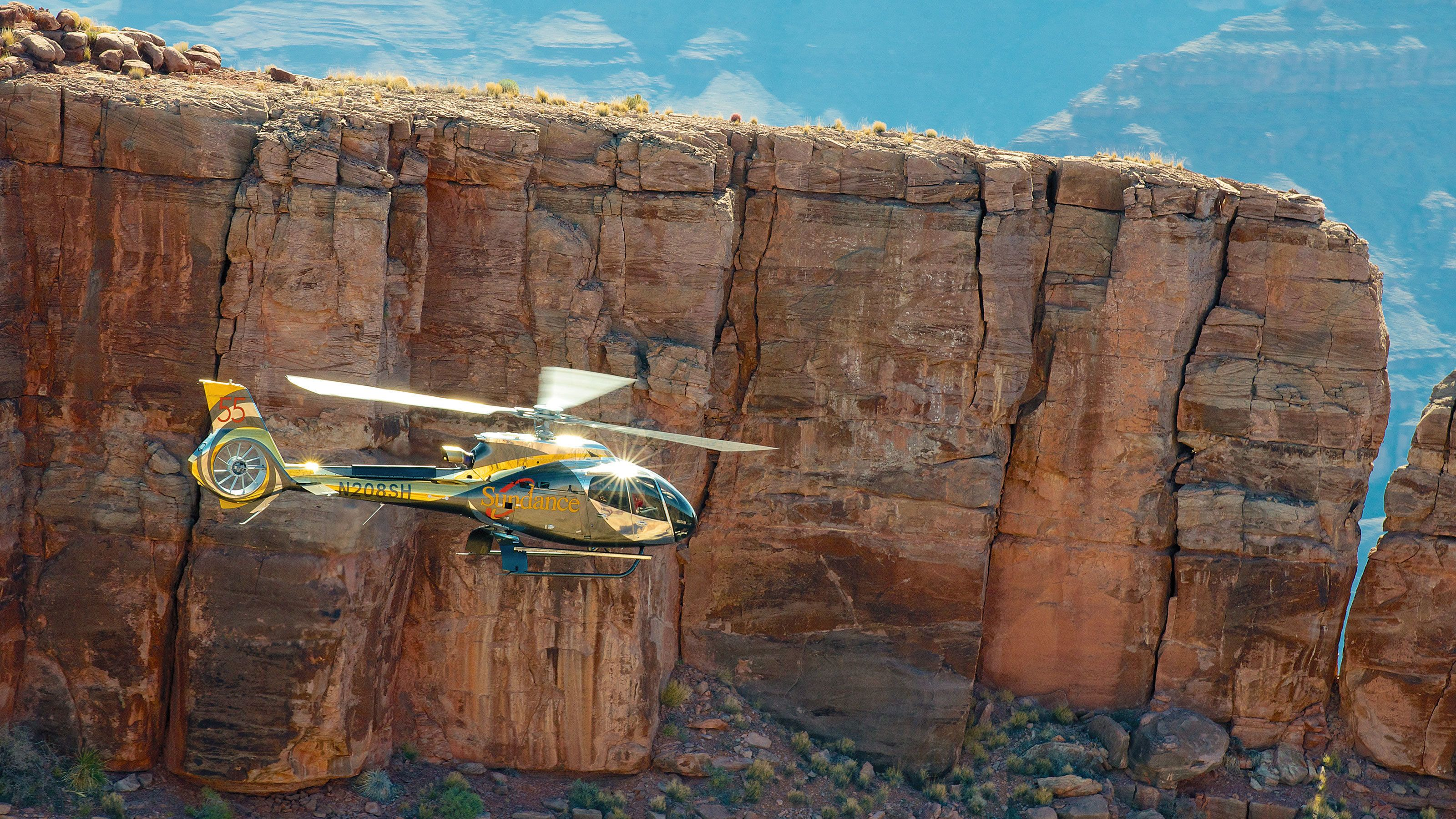 Flying helicopter with the canyon view in the background in Arizona