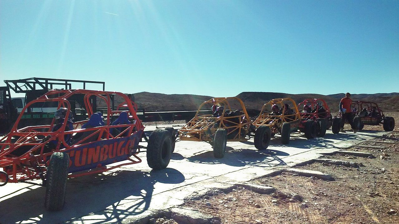 Dune buggys parked in the sun outside in Nevada