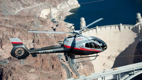 A Helicopter flying above the Hoover Dam