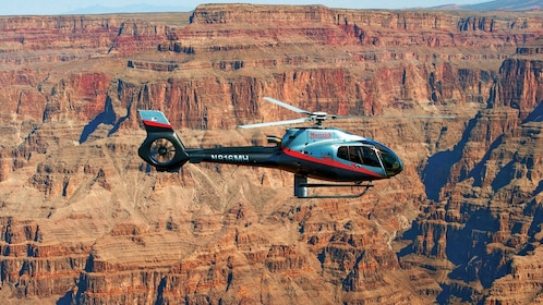 Helicopter flies above the Grand Canyon
