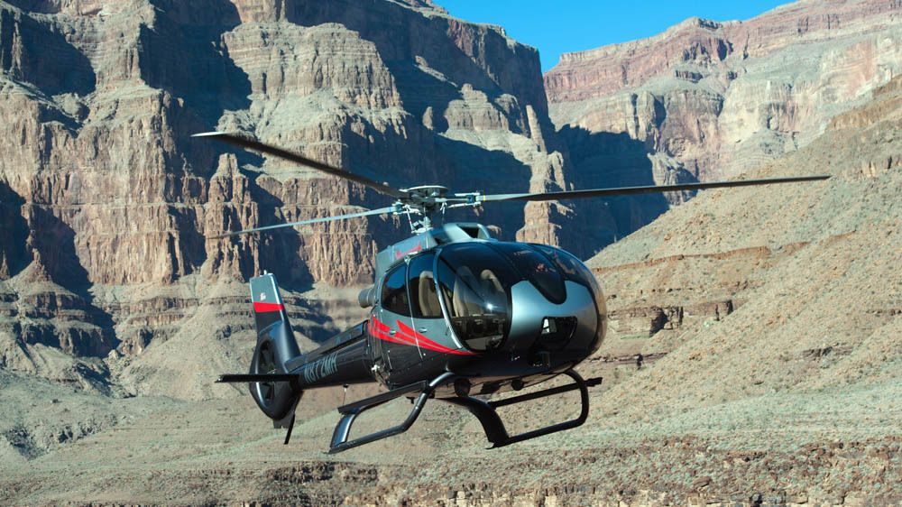 Helicopter flying over Hoover Dam.