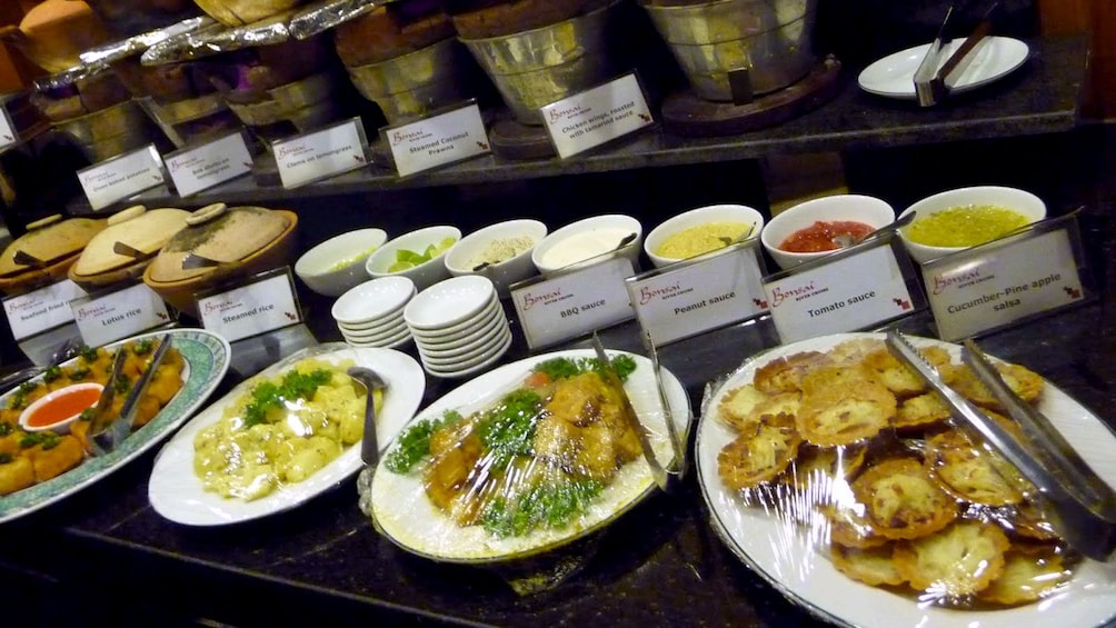 Show item 4 of 9. Buffet food station aboard the Saigon River Dinner Cruise in Ho Chi Minh City