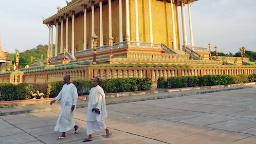 Two monks walking on the streets of Phnom Penh