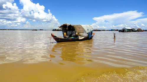 Boat sailing on a clear blue sky day in Tonle Bati in Phnom Penh