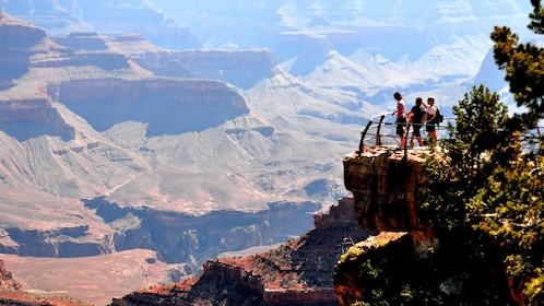 Tourists experiencing panoramic views of the Grand Canyon during the tour