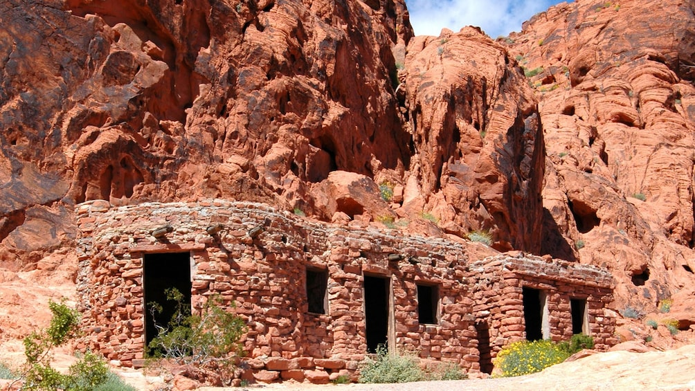 Show item 3 of 5. Cabins made of surrounding rocks used to escape the heat within the Valley of Fire