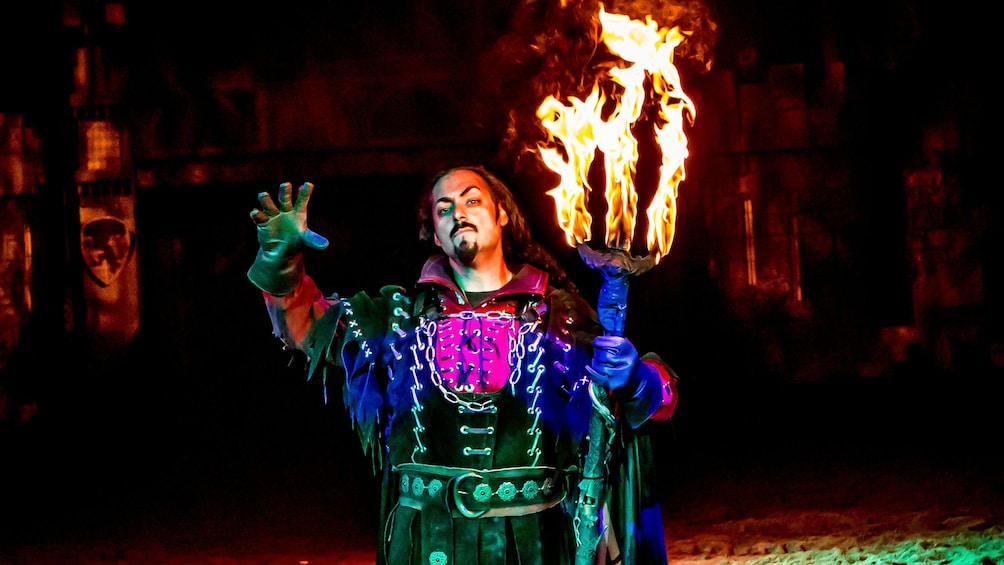 Show item 3 of 6. The infamous Mordred wizard casting a spell at the tournament of kings dinner show in Las Vegas