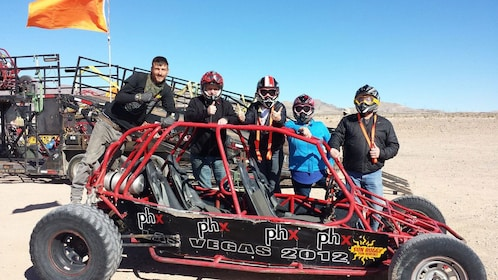 Group standing in back of dune buggy in Nevada