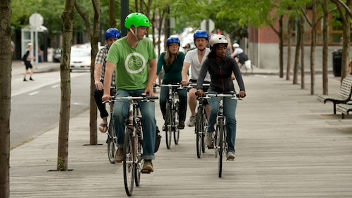 Bicycle riding group on sidewalks in Downtown Portland