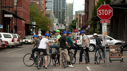 Bicycle riding group at stop sign in Downtown Portland