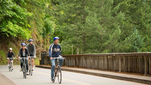People on bicycles along the Columbia River Gorge in Oregon