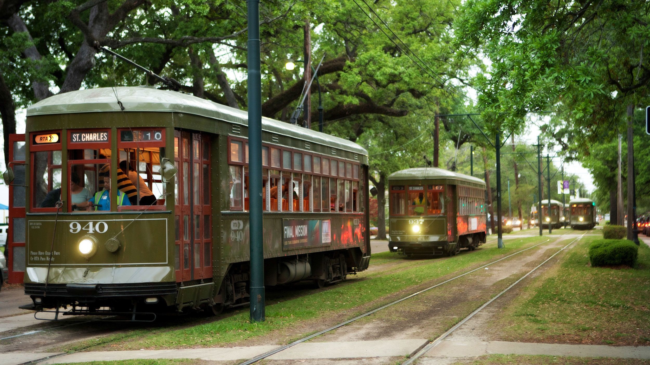 trolley cars driving down street in New Orleans