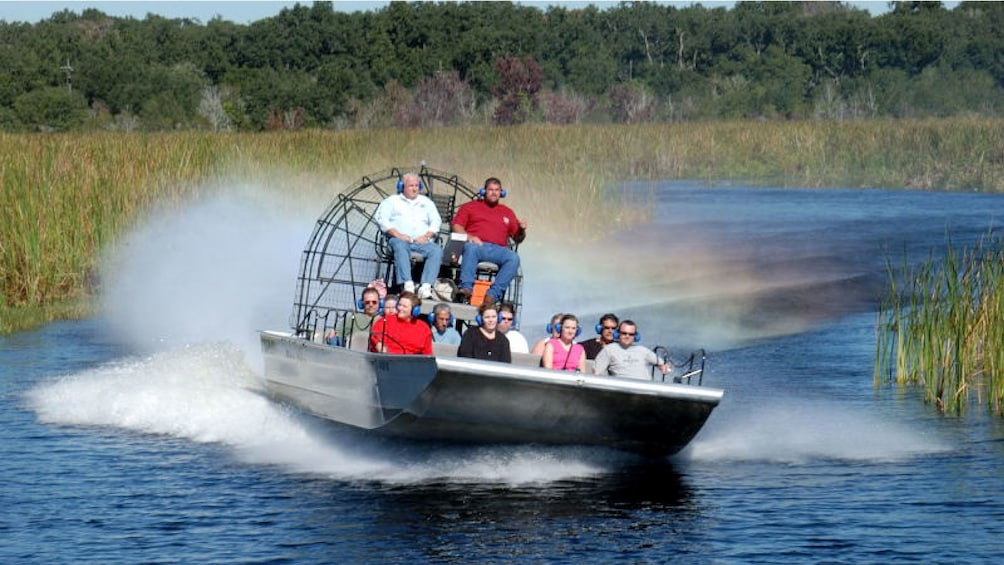 Show item 1 of 10. air boats sailing down lake in New Orleans