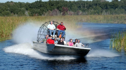 air boats sailing down lake in New Orleans
