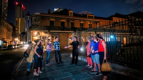 tour guide speaking to tourist at ghost tour in New Orleans