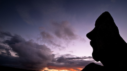 Close view of a sculpture on Easter Island at sunset