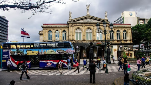 Double-decker VIP bus in front of Teatro Nacional in San Jose