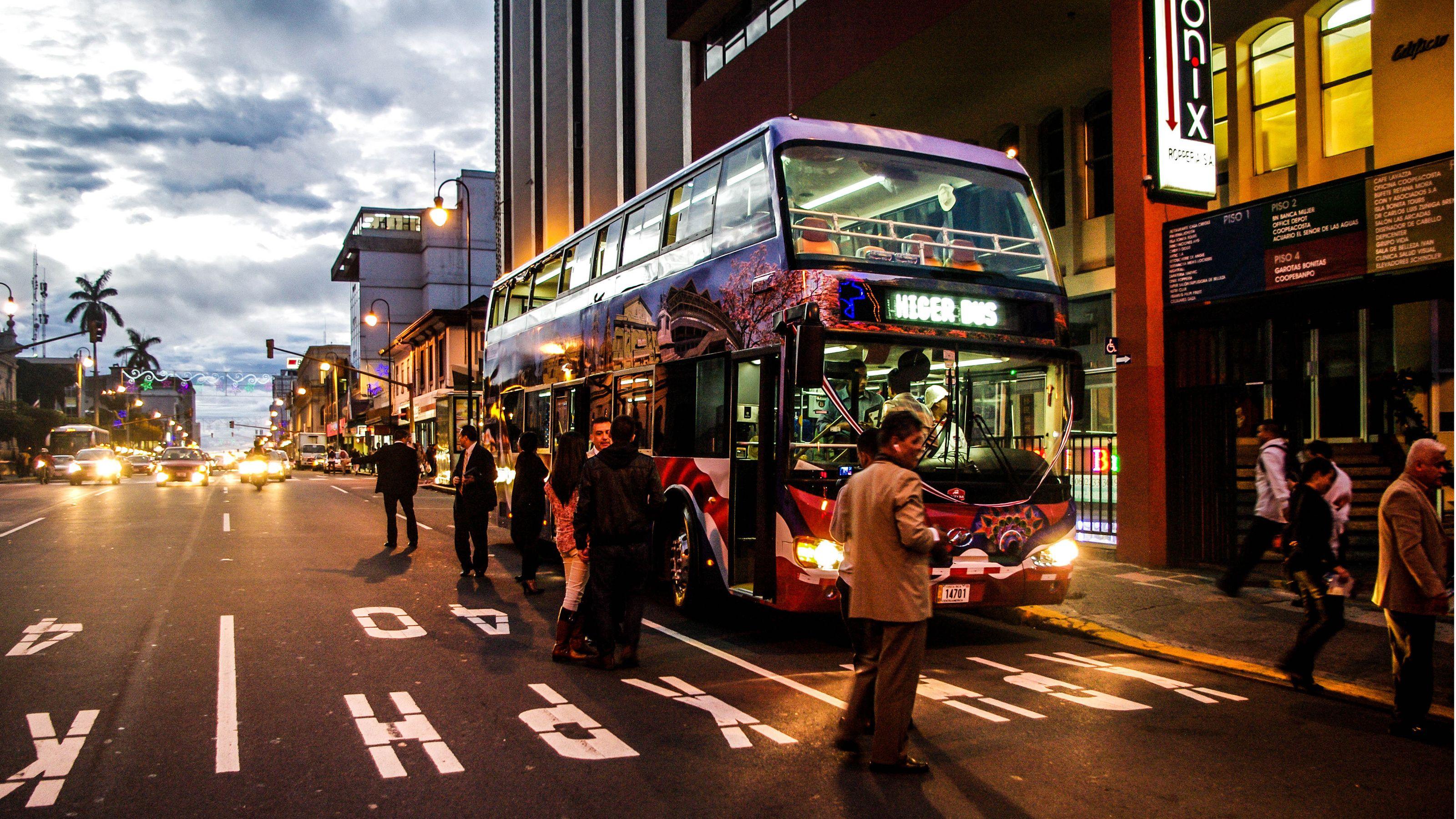 Double-decker VIP bus at night in San Jose