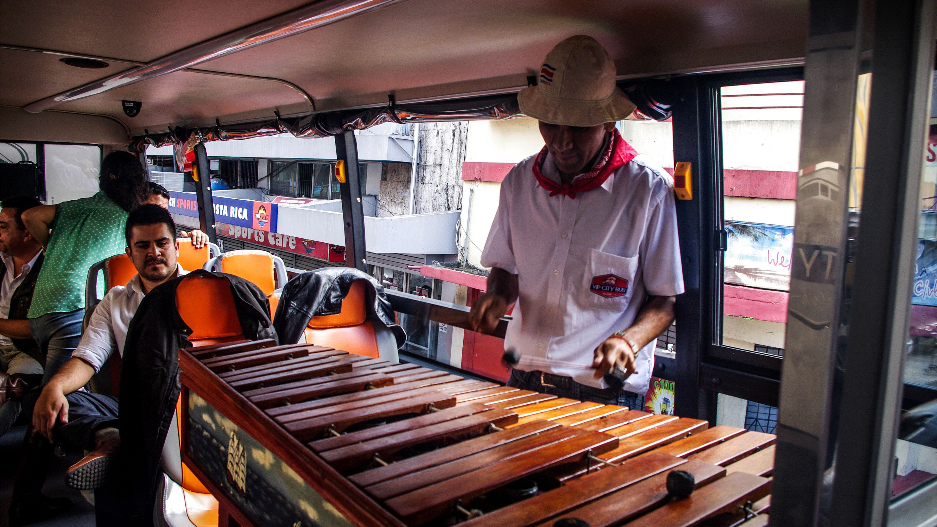 Live folk music is played on the double-decker VIP bus in San Jose