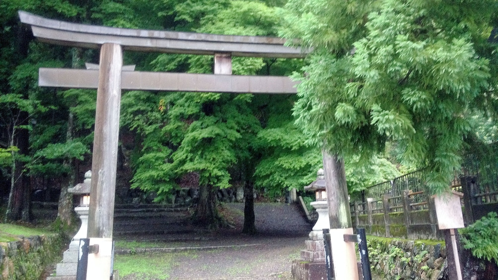 Show item 3 of 5. A torii gate at the entrance to a temple in Kyoto