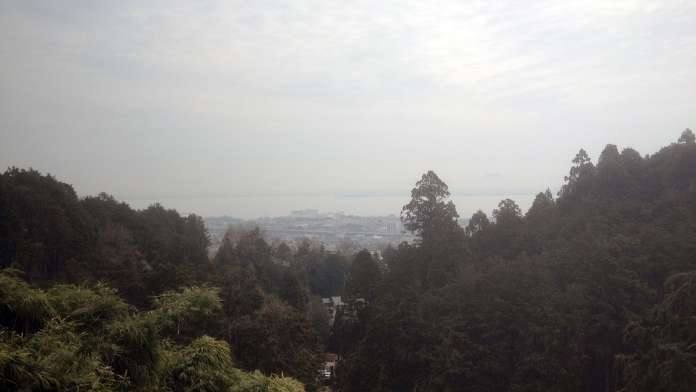 Show item 4 of 5. a view looking down at Kyoto and the coast on a misty morning