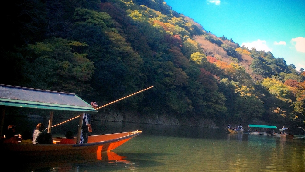Show item 4 of 7. People traveling down river in Kyoto