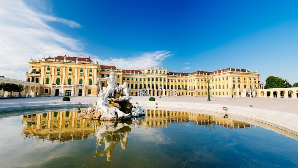 Show item 4 of 7. Schonbrunn Palace and courtyard fountain in Vienna
