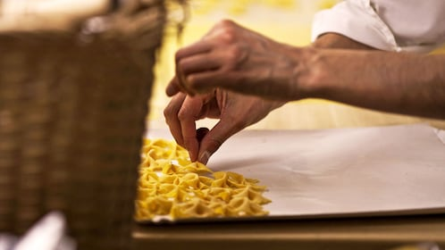 person sorting hand made pasta in Bologna