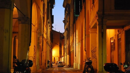 Cobblestone street in Bologna at sunset