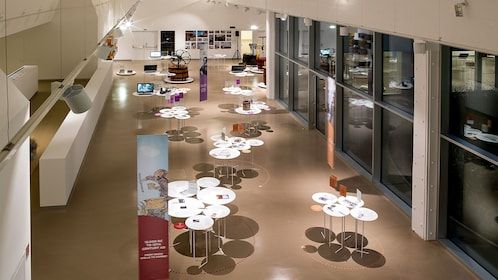 An assortment of tables inside a modern building in Bologna