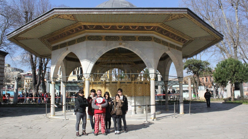 Tourist group stands for a picture in front of a building in Istanbul