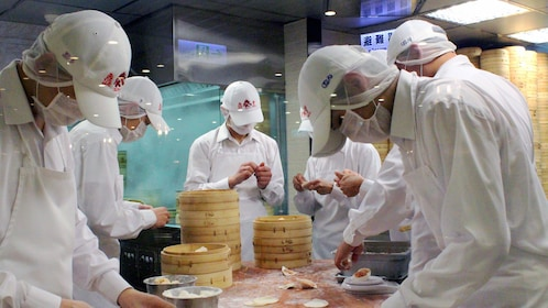 making dumplings in taipei
