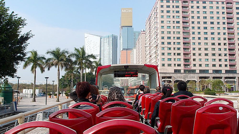 A view of buildings in Macau from a hop on hop off bus