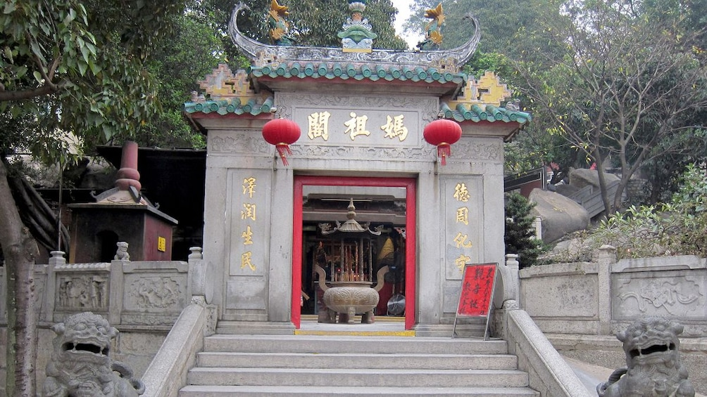 Show item 4 of 7. The entrance to a temple in Macau