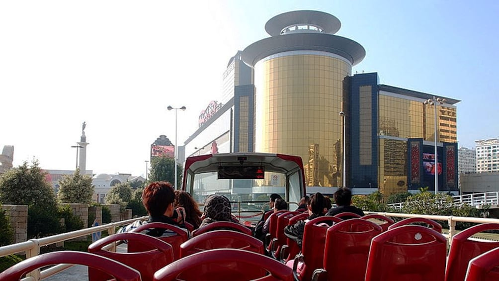 Show item 5 of 7. A view of Macau from the top of a hop on hop off bus