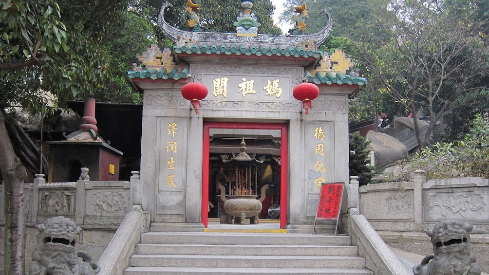 Show item 5 of 5. The entrance to a temple in Macau