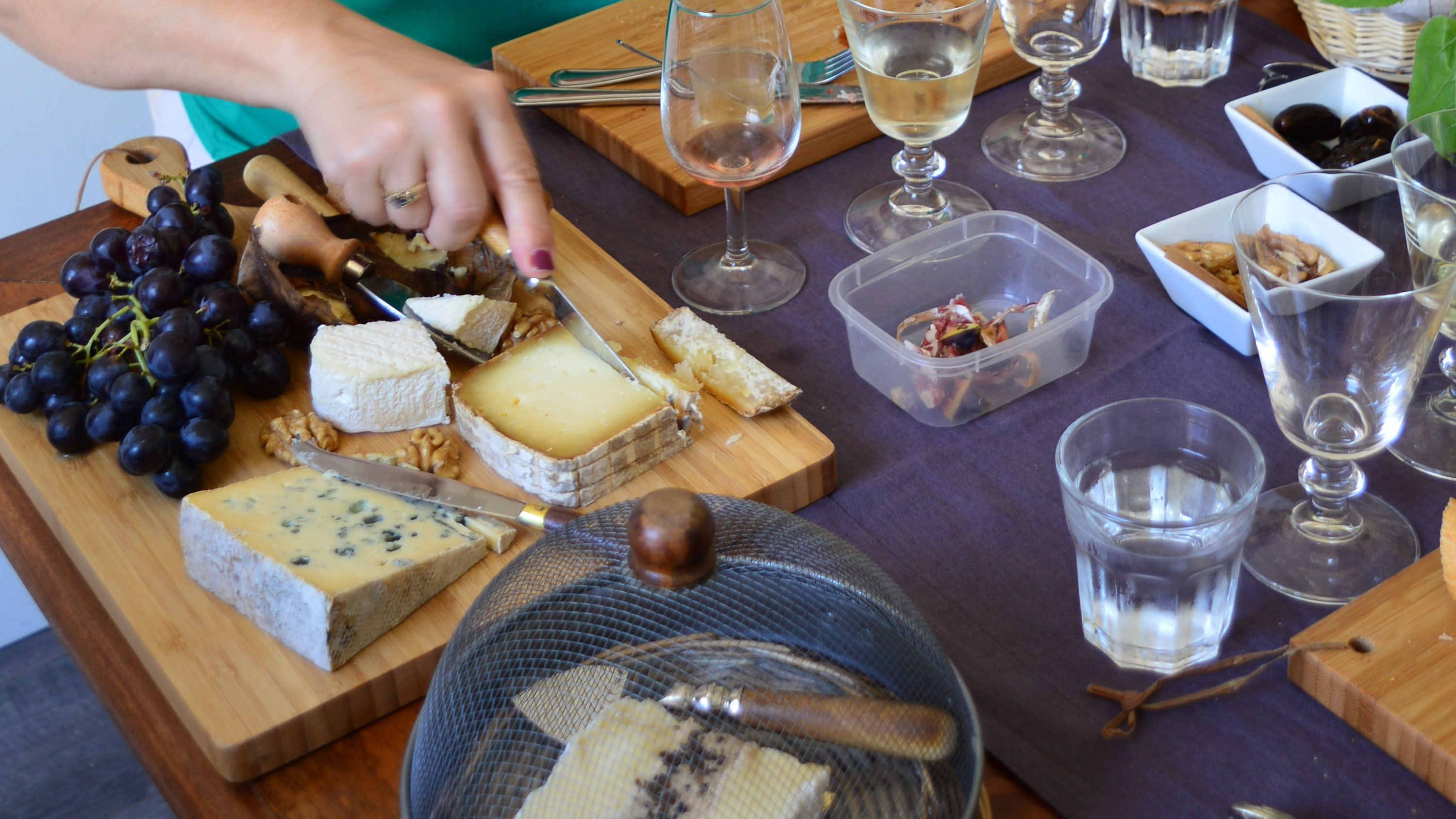 Cheese being cut at the cheese and wine tasting in Cannes