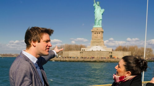 Tour guide talking to group about the Statue of Liberty in New York
