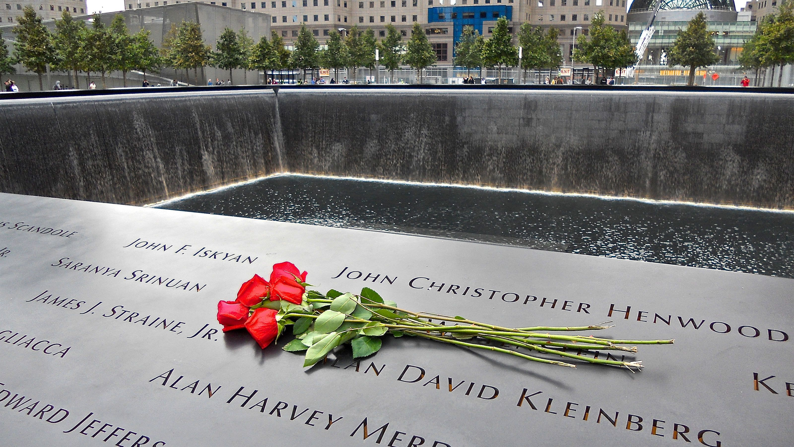 Roses on the engraved names at the National September 11 Memorial in New York