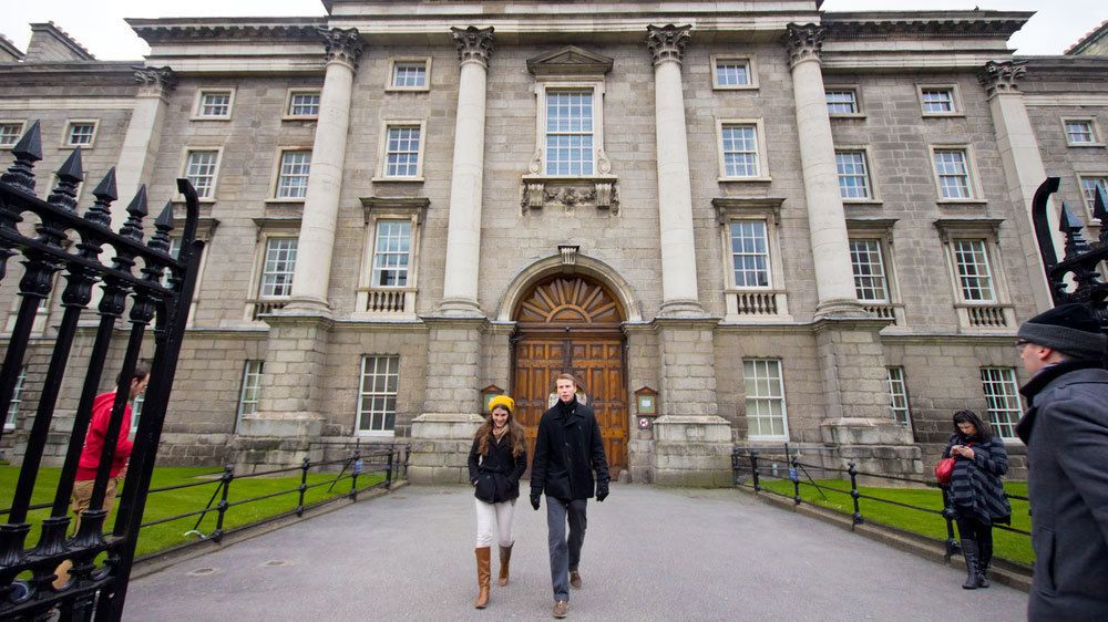 man and woman walking away from library in Dublin