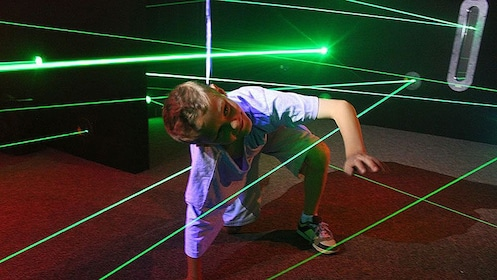 Child attempting to avoid security lasers at the Ripley's Believe It or Not in Pattaya