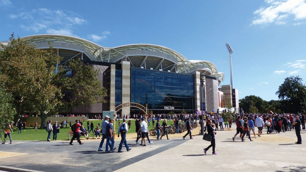 Show item 3 of 4. Walking people enjoying the Adelaide City Highlights Tour in Australia.
