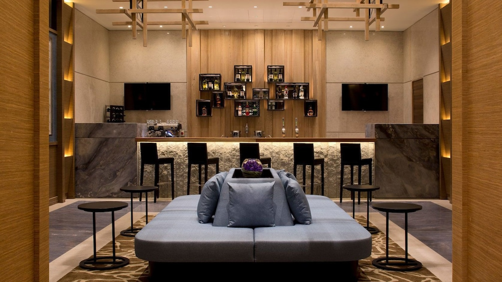 Show item 3 of 5. comfortable couch and stools at Plaza Premium Lounge in London