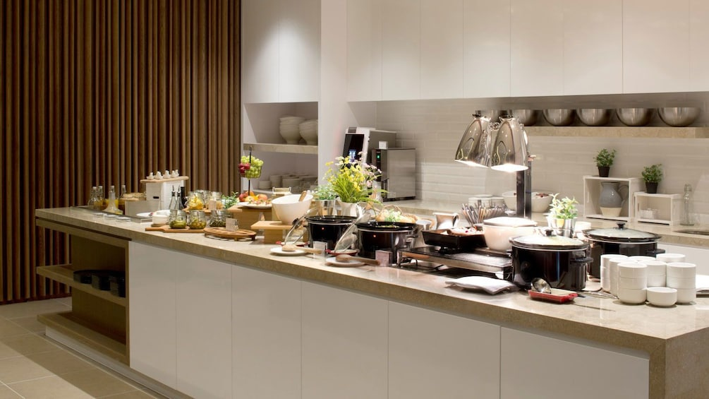 Show item 3 of 5. kitchen area with buffet at Plaza Premium Lounge in London