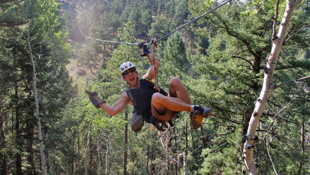 Show item 5 of 5. Having a blast ziplining in Denver