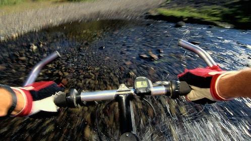 Biking through a shallow creek in Denver