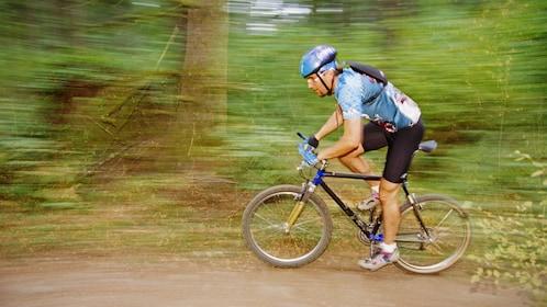 Mountain biking along a wooded trail in Denver