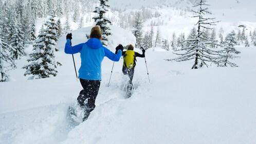 Kids excitedly snowshoeing in Denver