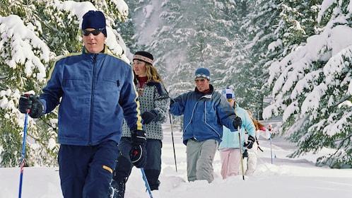 Group snowshoeing in knee deep snow in Denver